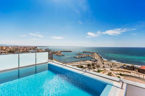 modern Pool by Bornelo Interior Design