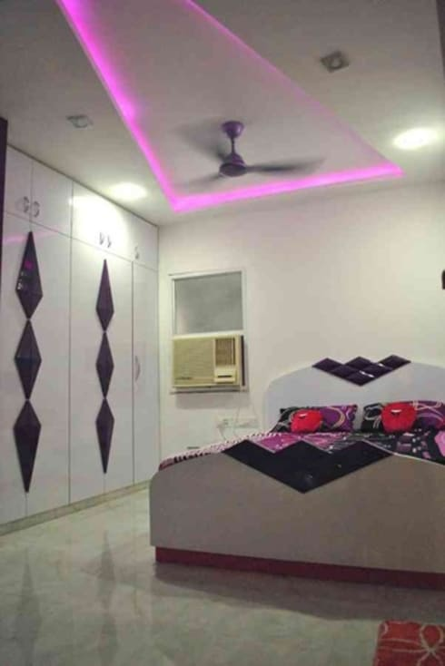 Vikas singh apartment : modern Bedroom by Arturo Interiors