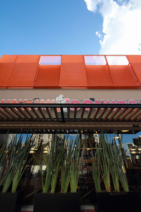 Dunkin' Donuts Tecamachalco: Casas de estilo industrial por Metro arquitectos