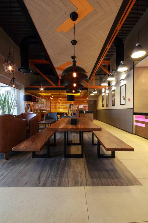 Dunkin' Donuts Tecamachalco: Comedores de estilo industrial por Metro arquitectos