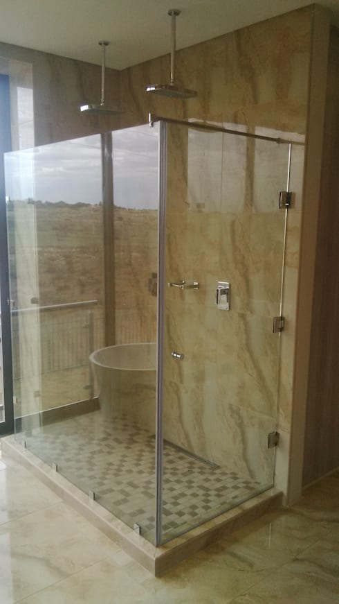 Our range of doors,windows,mirrors,showers,splash backs , etc… … .: modern Bathroom by Tech Glass and Aluminium
