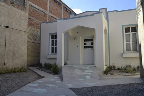 Nueva Cara:  de estilo  por CUBO ROJO Arquitectura