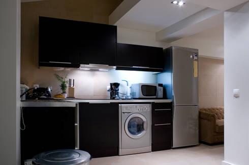 After - Kitchen:   por Architecture Tote Ser