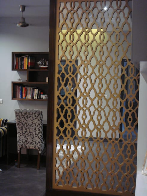 MDF partition finished in dull gold: mediterranean Bedroom by renu soni interior design