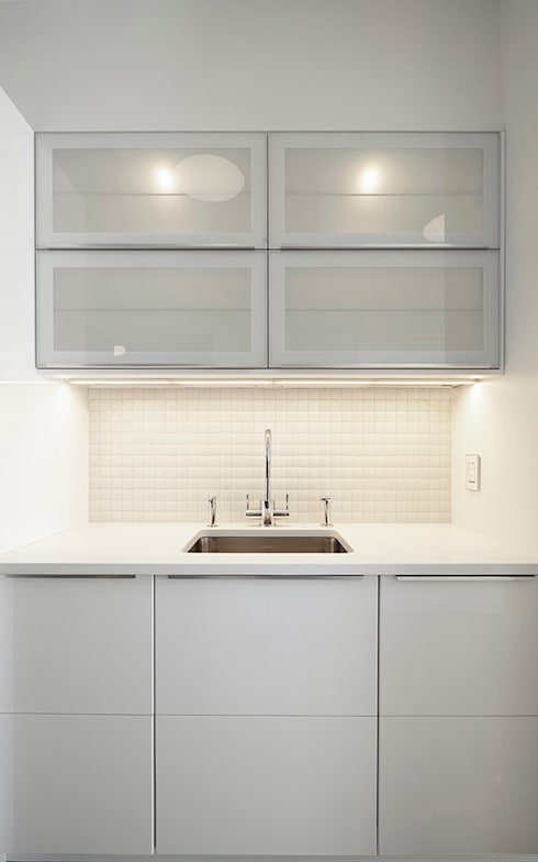 Downtown White on White Apartment:  Kitchen by Andrew Mikhael Architect