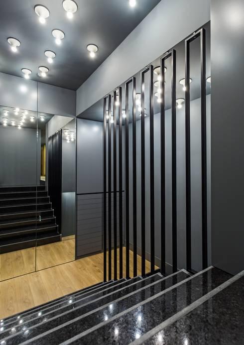OMR_MTS1A_10: Espaços comerciais  por XYZ Arquitectos Associados