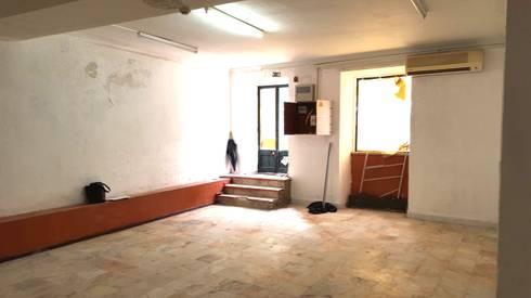 Zona de entrada /Antes: Clínicas  por IsabelazevedoArquitectura&Interiores