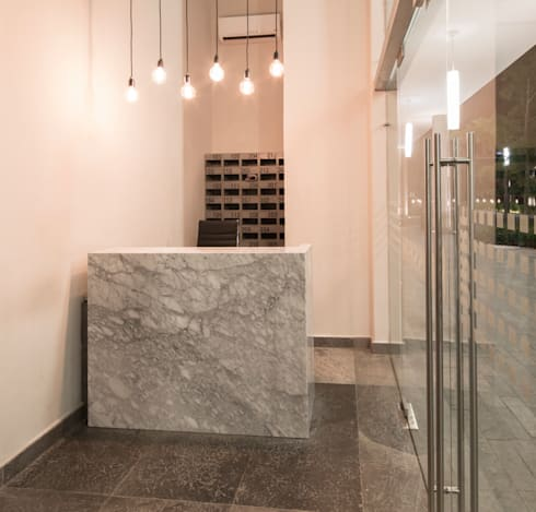 LOBBY: Edificios de Oficinas de estilo  por Rousseau Arquitectos