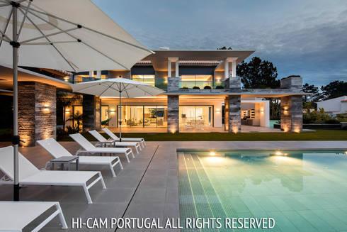 Monte Golf: Casas modernas por Hi-cam Portugal