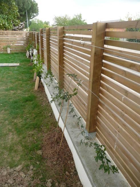 Clôture bois: Jardin de style  par Constans Paysage