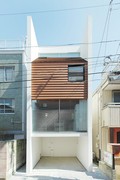 サンドイッチハウス: こぢこぢ一級建築士事務所が手掛けた家です。