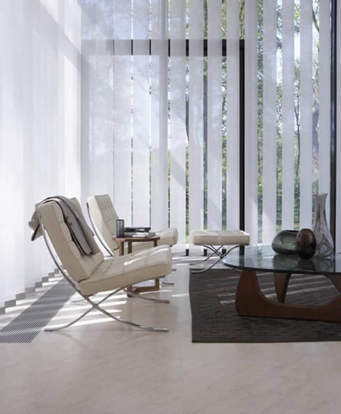 CORTINAS QUE VISTEN LOS ESPACIOS: Livings de estilo  por L&S arquitectos