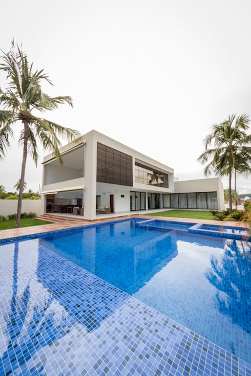 Casas de estilo  por Carolina Mota - Arquitetura, Interiores e Iluminação