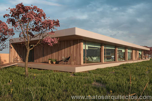 House by River side: Casas modernas por Matos Architects