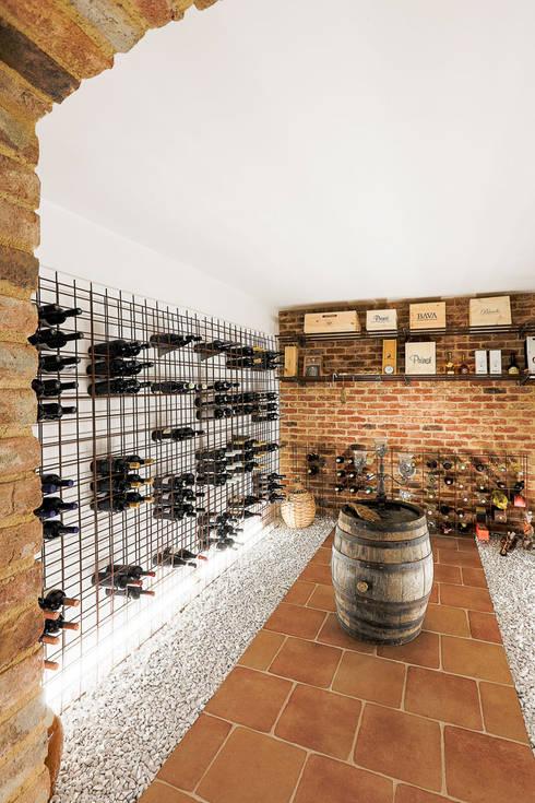 Cave à vin de style  par Hunkeler Partner Architekten AG