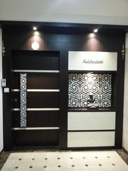 enterance : modern Living room by NCA  naresh chandwani & associates