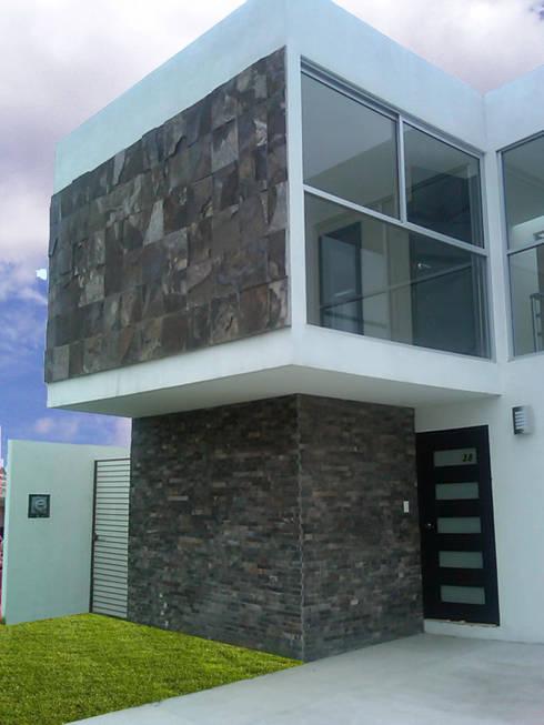 Casas de estilo  por CCA|arquitectos