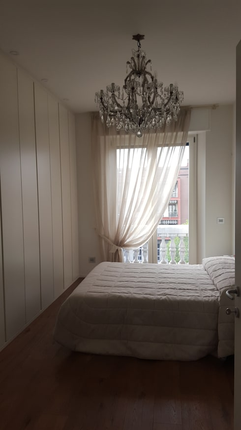 غرفة نوم تنفيذ studio di architettura cinzia besana