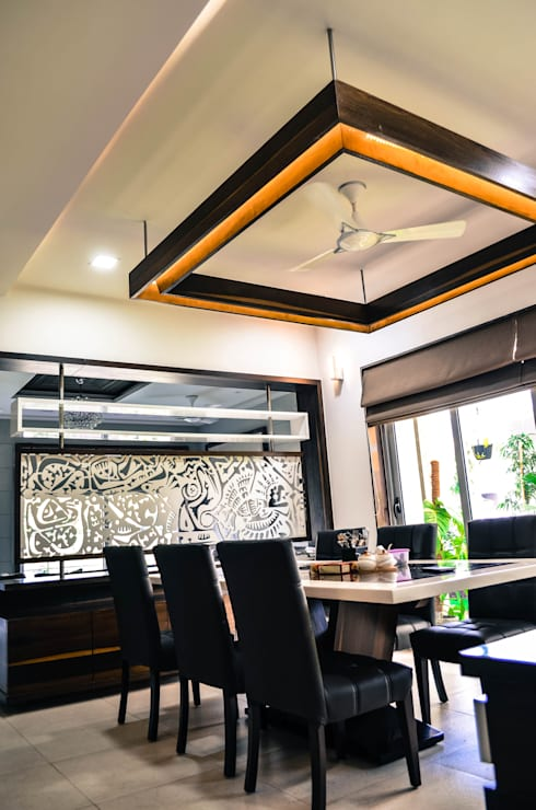 Interior For Mr. Shah:  Dining room by Maulik Vyas Architects