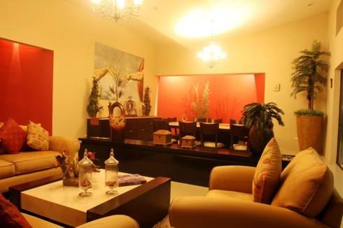 Casa OC: Salas de estilo moderno por AIDA TRACONIS ARQUITECTOS EN MERIDA YUCATAN MEXICO