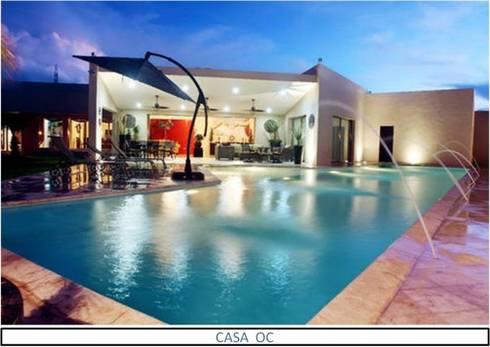 Casa OC: Albercas de estilo moderno por AIDA TRACONIS ARQUITECTOS EN MERIDA YUCATAN MEXICO