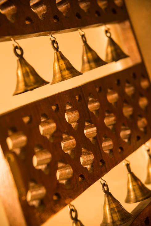 temple door with bells:  Artwork by iSTUDIO Architecture