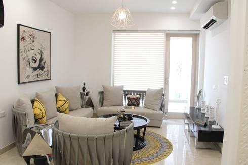 Shanker Greens, Agra: modern Living room by INFINITY