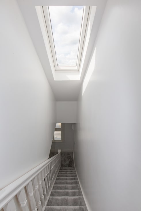A roof window to brighten up the hallway!:  Corridor & hallway by The Market Design & Build