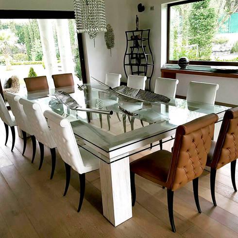 Casa Estado de México: Comedores de estilo moderno por Interia Muebles