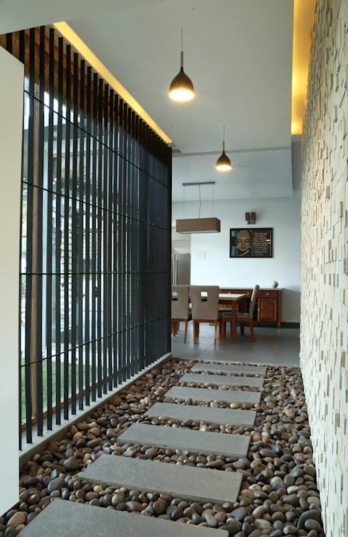 Kasliwal bungalows:  Corridor & hallway by 4th axis design studio