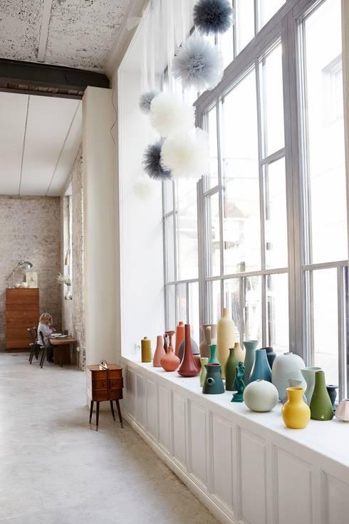 Salas/Recibidores de estilo industrial por Design for Love