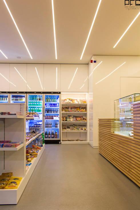 LOJA CONVENIÊNCIA DG 01_ESPOSENDE_2015: Lojas e espaços comerciais  por PFS-arquitectura