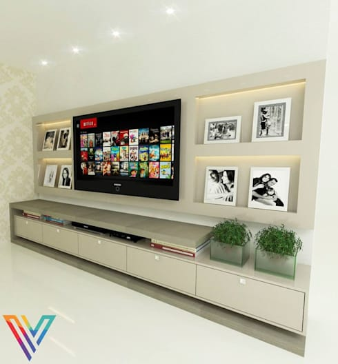 Painel da TV: Sala de estar  por Vitral Studio Arquitetura