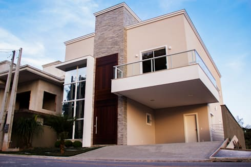 Casa QE148: Garagens e arrecadações modernas por Cecyn Arquitetura + Design
