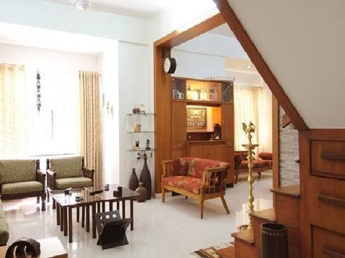 Wood, Wood and Lots Of Wood .....: classic Living room by Nishtha interior