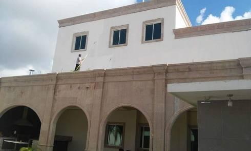 Fachada Trasera: Casas de estilo moderno por DIIA