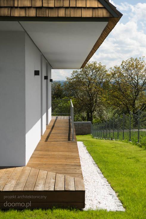 architektura www.doomo.pl, wnętrza www.minimoo.pl: styl , w kategorii Domy zaprojektowany przez MINIMOO Architektura Wnętrz