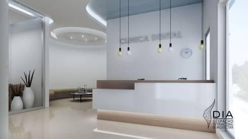 Recepcion : Oficinas y tiendas de estilo  por DIIA
