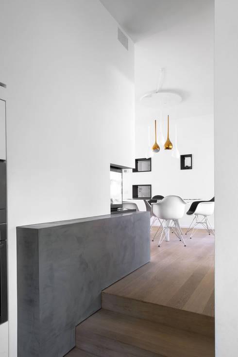 Livings de estilo  por EXiT architetti associati
