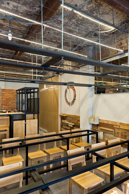Wok-Inn: Restaurantes de estilo  por Estudio Manuel Peredo