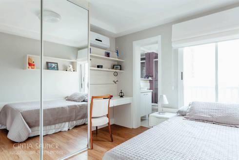 dormitorio filha: Quarto  por Cintia Sauner Arquitetura e interiores