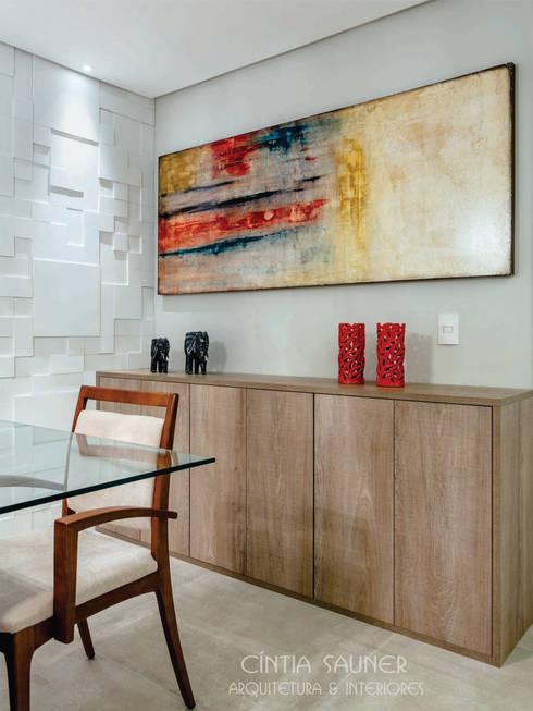 aparador: Sala de jantar  por Cintia Sauner Arquitetura e interiores