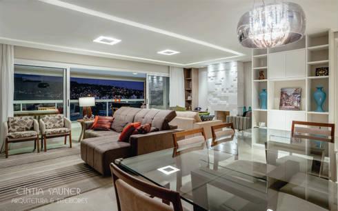 estar e jantar: Sala de estar  por Cintia Sauner Arquitetura e interiores