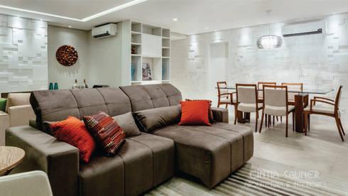 estar + iluminação: Sala de estar  por Cintia Sauner Arquitetura e interiores