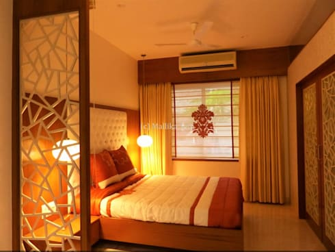 Interiors for a Villa at Ferns Paradise, Bangalore: industrial Bedroom by Mallika Seth