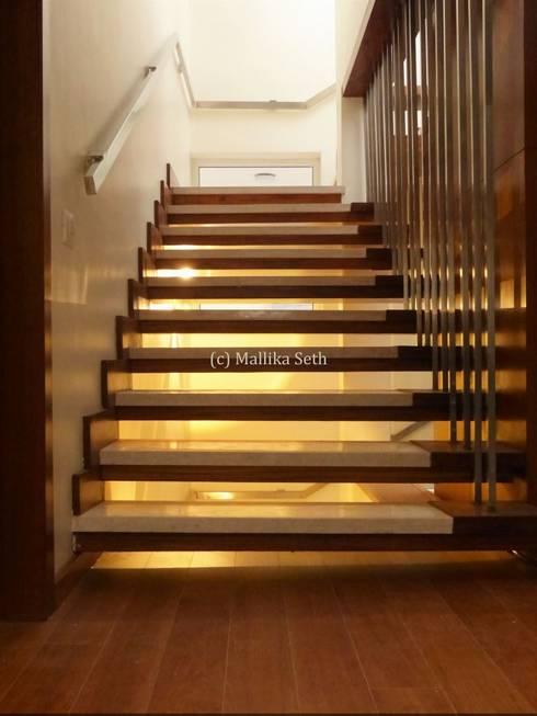 Interiors for a Villa at Ferns Paradise, Bangalore:  Corridor & hallway by Mallika Seth