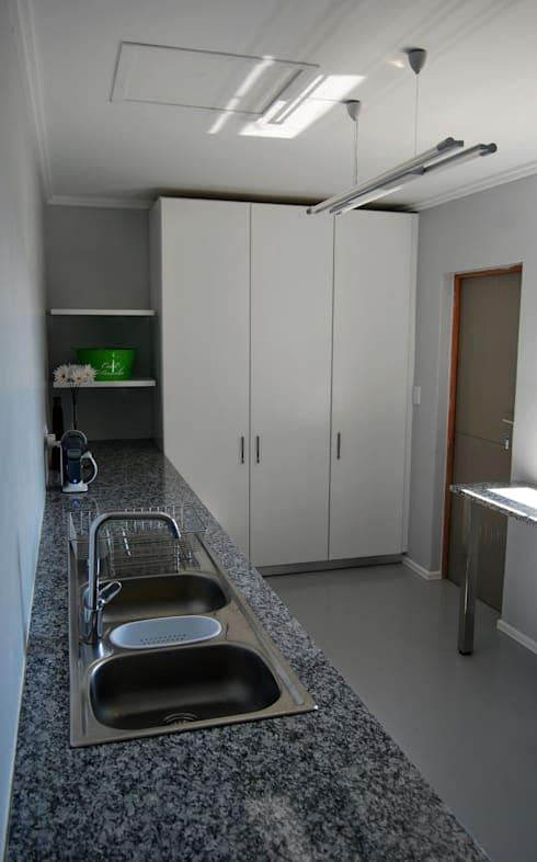 LC Interiors: modern Kitchen by Capital Kitchens cc