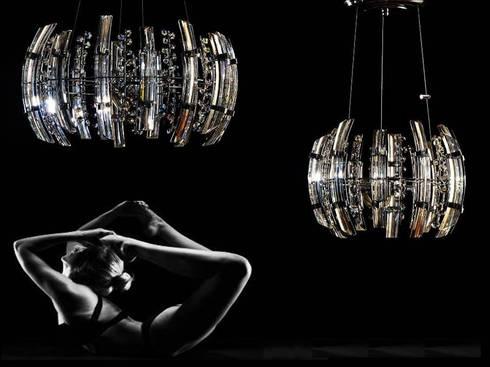 Olimpia : Salas/Recibidores de estilo moderno por Goldencris