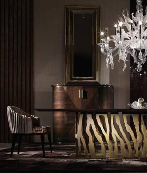 Roberto Cavalli Home Interiors: Sala de jantar  por SumptuosEsfera Unipessoal, Lda