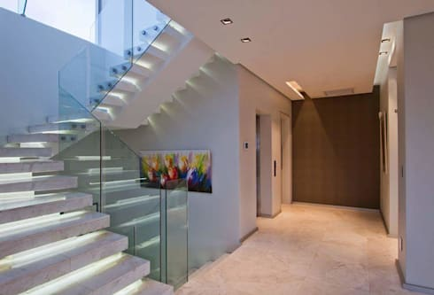 Incredible modern house in the heart of Ballito:  Corridor & hallway by CA Architects